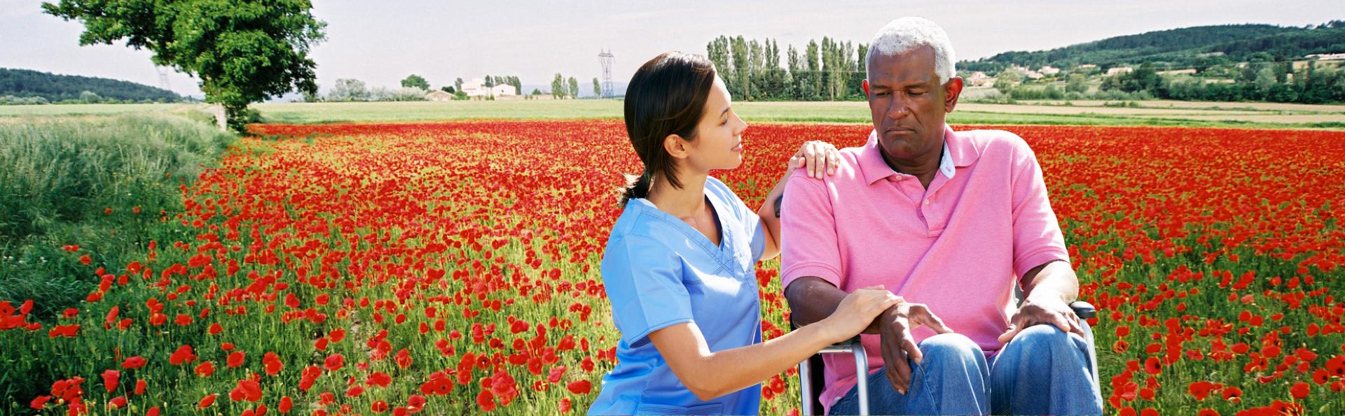 caregiver comforting senior man