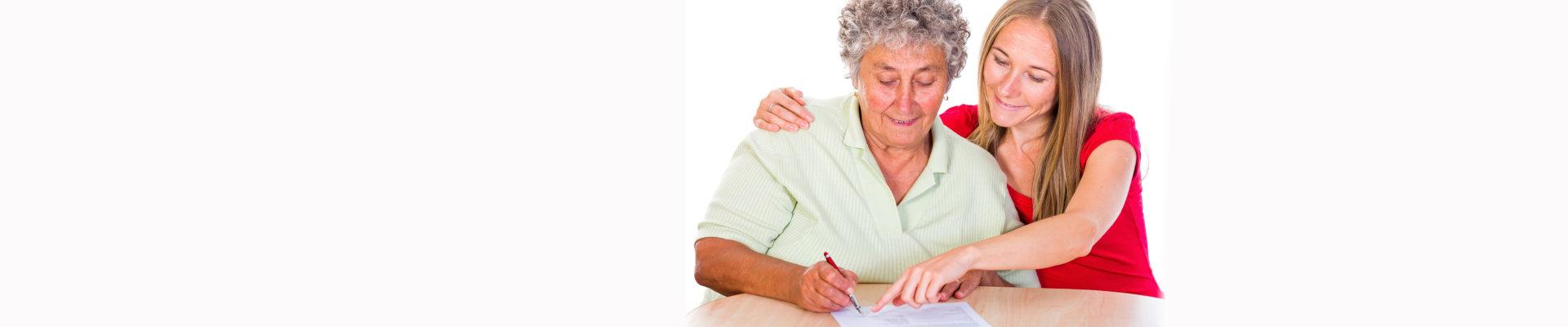 caregiver assisting a caregiver to write