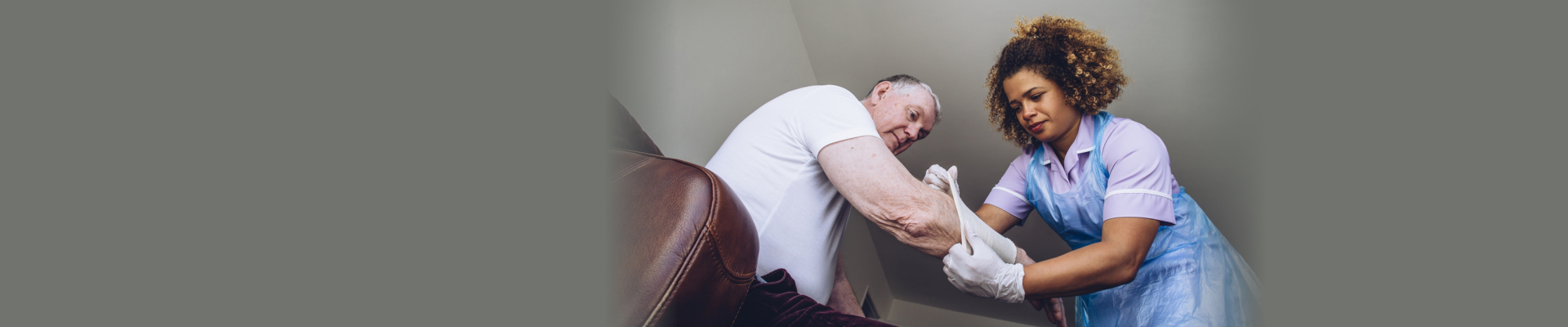 caregiver covering elderly man's arm